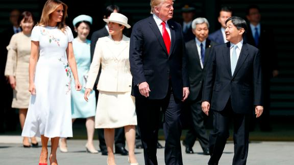 President Donald Trump and first lady Melania Trump are escorted by Emperor Naruhito and empress Masako during a welcome ceremony at the Imperial Palace in Tokyo on Monday.