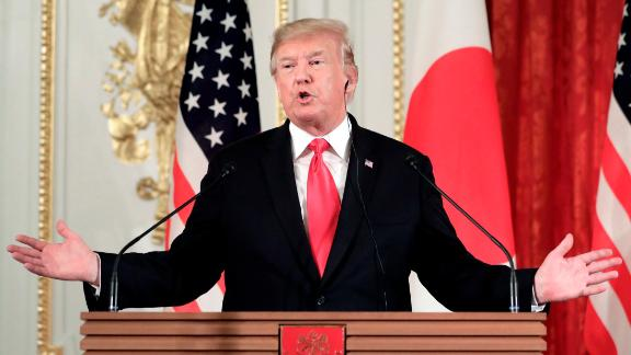 U.S. President Donald Trump, gestures as he speaks during a news conference with Shinzo Abe, Japan