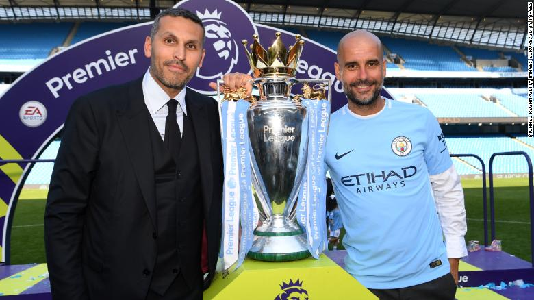 Manchester City chairman Khaldoon Al Mubarak (left) poses with Pep Guardiola after winning EPL title.