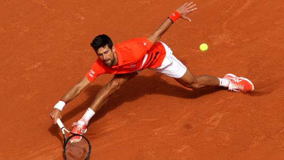 Novak Djokovic stretched here but wasn't stretched in his opener, looking sharp in dispatching rising Pole Hubert Hurkacz.
