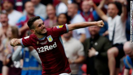Aston Villa's Scottish midfielder John McGinn celebrates after scoring the decisive second goal on Monday.
