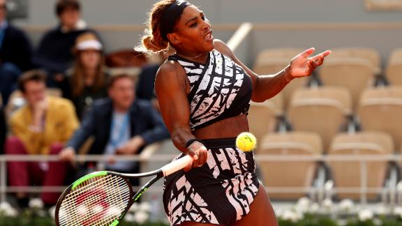 Serena Williams hits a forehand in her first-round match at the French Open.