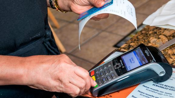 Miami Beach, Tropical Beach Cafe credit card scanner. (Photo by: Jeffrey Greenberg/UIG via Getty Images)