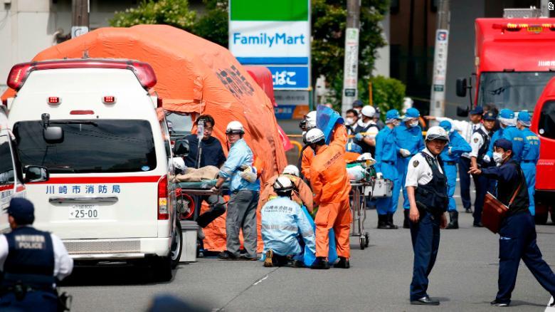 Rescuers work at the scene in Kawasaki.