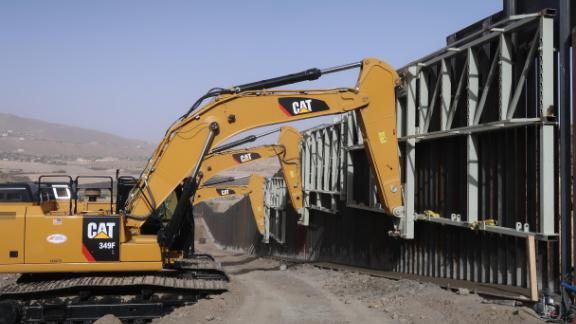 CNN observed crews working the US-Mexico border near the New Mexico-Texas state line with machinery Monday.