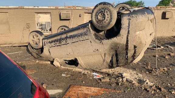 Mud covers a flipped car in Celina, Ohio, on May 28.