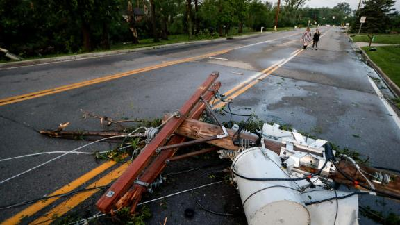 A utility pole lies in a street in Vandalia, Ohio. More than 70,000 utility customers were without power in Ohio, the weather service in Wilmington said early May 28, citing data from the US Department of Energy.