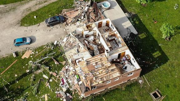 "An aerial photo shows a damaged home in Brookville, which is a suburb of Dayton. ""We went out in the streets and children were screaming and crying,"" Brookville resident Michael Sussman told CNN. ""Devastation everywhere."""