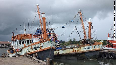 By dragging a large net between them, these Thai pair trawlers catch more fish than two boats operating independently.