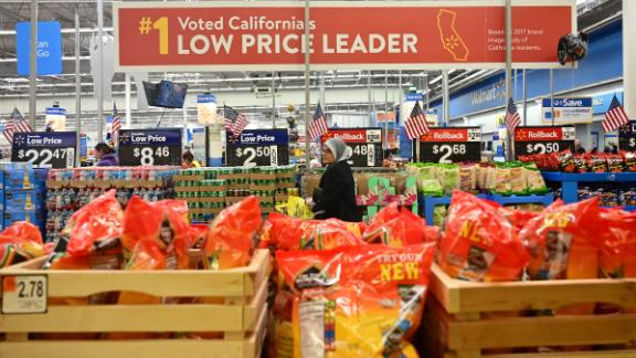 People shop at a Walmart Supercenter store in Rosemead, California on May 23, 2019. - Walmart has said it will raise prices as a result of the Trump administration's tariffs on Chinese-made goods as the trade war is about to take a bite into the retail sector affecting consumers shopping at stores like Walmart, Target and Macy's. (Photo by Frederic J. BROWN / AFP)        (Photo credit should read FREDERIC J. BROWN/AFP/Getty Images)