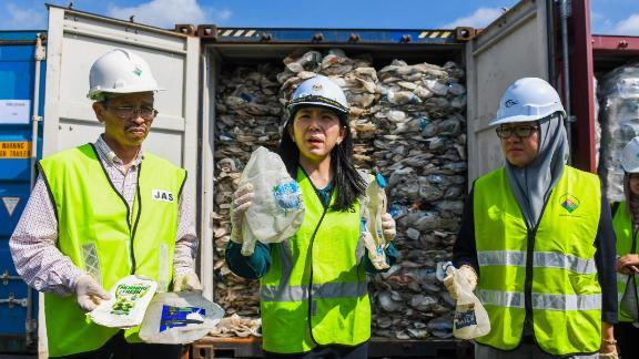 Malaysian Minister of Energy, Science, Technology, Environment and Climate Change Yeo Bee Yin shows samples of plastics waste shipment from Australia on May 28, 2019.