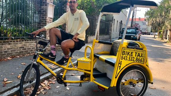 Zachary Viscidi works two jobs: a middle school social studies teacher and a pedicab driver.