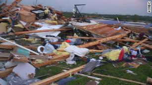 Hiding under a mattress with his family, he watched his home 'just leave' as a tornado churned through