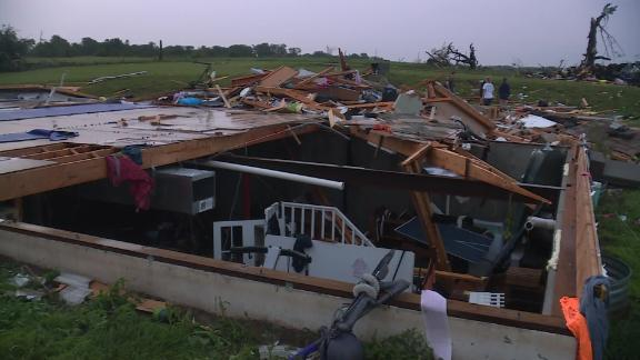 Brian Hahn and his family were under the only part of the house that the tornado didn't wipe away.