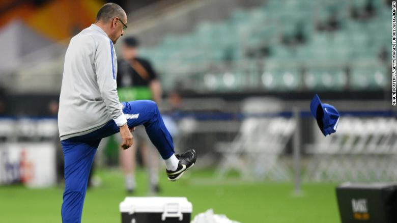 Chelsea boss Sarri kicks his hat in frustration ahead of the Europa League final