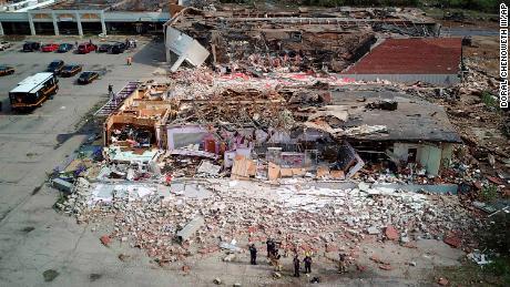 A shopping center in Dayton, Ohio,  lies in shambles after a tornado struck Tuesday.