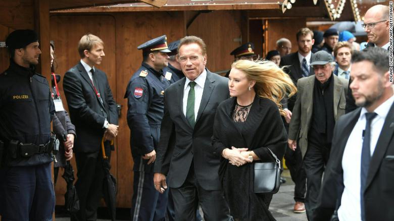 Arnold Schwarzenegger and girlfriend Heather Milligan arrive at St. Stephen's in Vienna.