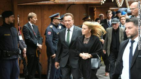 Arnold Schwarzenegger and girlfriend Heather Milligan arrive at St. Stephen's in Vienna.