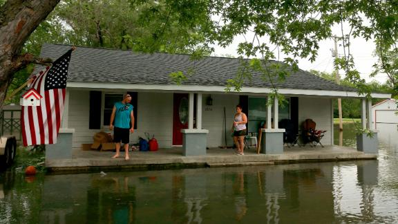 Nick Sweeney and his wife, Tara, watch the water level from their home in Portage Des Sioux, Missouri.