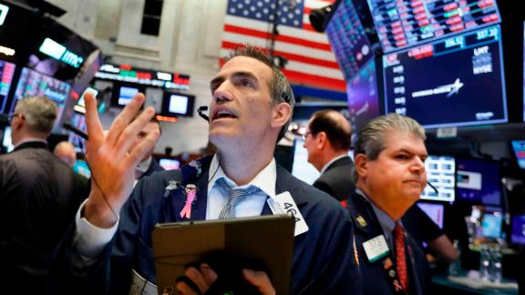 Traders Gregory Rowe, left, and John Panin work on the floor of the New York Stock Exchange, Wednesday, May 29, 2019. Stocks are getting off to a weak start on Wall Street led by drops in technology and health care companies. (AP Photo/Richard Drew)