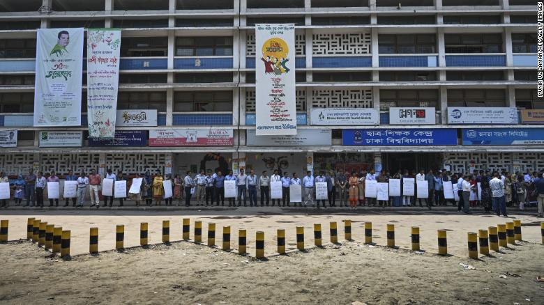Members of the Transparency International Bangladesh group stand in a human chain during a protest in Dhaka on April 21, 2019, following Nusrat Jahan Rafi's murder.