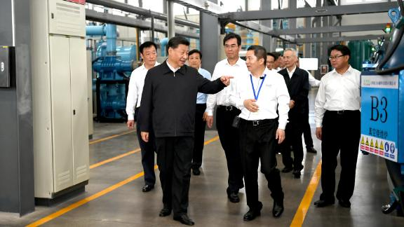 GANZHOU, May 20, 2019 -- Chinese President Xi Jinping, also general secretary of the Communist Party of China Central Committee and chairman of the Central Military Commission, learns about the production process and operation of the JL MAG Rare-Earth Co. Ltd. as well as the development of the rare earth industry in the city of Ganzhou in east China