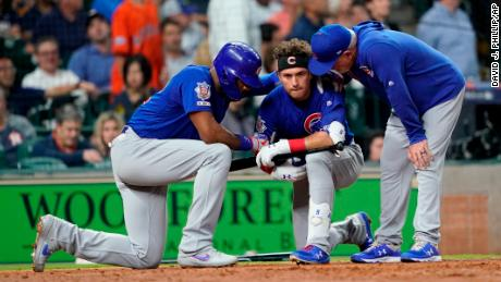 Cubs outfielder Albert Almora Jr. is consoled after he hit a foul ball that struck a fan.