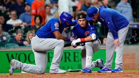 Chicago Cubs' Albert Almora Jr., center, takes a knee as Jason Heyward, left, and manager Joe Maddon, right, talk to him after hitting a foul ball into the stands during the fourth inning of a baseball game against the Houston Astros Wednesday, May 29, 2019, in Houston. (AP Photo/David J. Phillip)