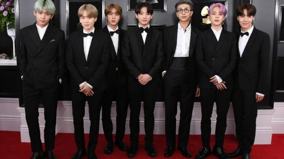 BTS attend the Grammy Awards where they become the first K-pop group to present an award on February 10, 2019, in Los Angeles.