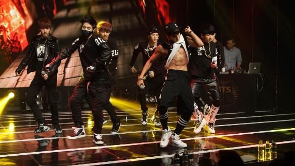 Singer Park Ji-min -- better known as Jimin -- exposes his six-pack as BTS perform during their debut.