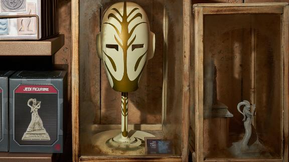 A Jedi Temple Guard mask is on display.