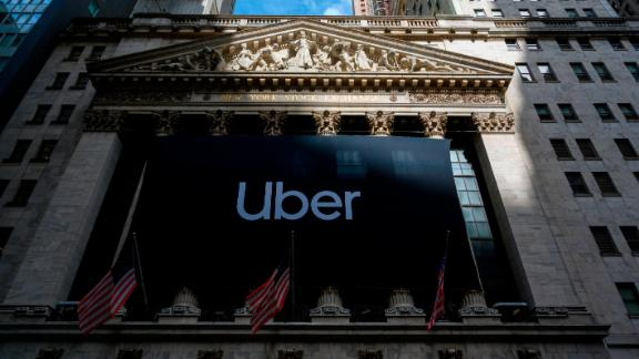 An Uber banner adorns the facade of the New York Stock Exchange ahead of the ride sharing company