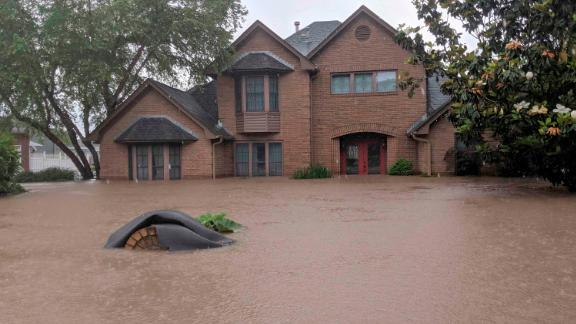 Flood waters surround homes in Fort Smith, Arkansas, on Wednesday.
