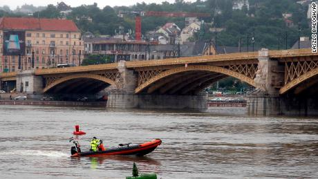 A rescue boat searches for survivors on the River Danube in Budapest, Hungary.
