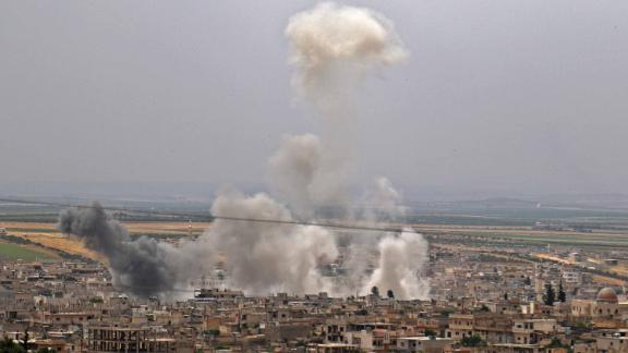 Plumes of smoke rising in the town of town of Khan Sheikhoun in Idlib following reported Syrian government bombardment on May 23.
