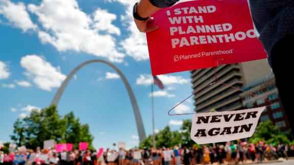 Abortion-rights supporters stand on both sides of a street near the Gateway Arch as they take part in a protest in favor of reproductive rights Thursday, May 30, 2019, in St. Louis. A St. Louis judge heard an hour of arguments Thursday on Planned Parenthood