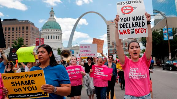 Abortion-rights supporters march Thursday, May 30, 2019, in St. Louis. A St. Louis judge heard an hour of arguments Thursday on Planned Parenthood