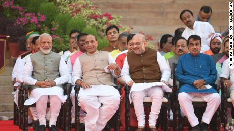 Narendra Modi (left) looks on next to BJP President Amit Shah (second from right) and Modi's first-term Home Affairs Minister Rajnath Singh (second from left) before his swearing-in as Indian Prime Minister on May 30.