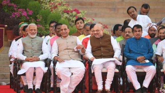Narendra Modi (L) looks on as he sits next to Bharatiya Janata Party President Amit Shah (2R) and Minister of Home Affairs of India Rajnath Singh (2L) before Modi