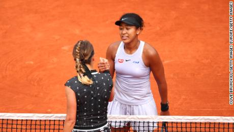 Naomi Osaka (in cap) and Victoria Azarenka shake hands after their match at the French Open.
