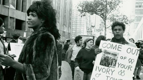 A 1970 photo of Marsha P. Johnson handing out flyers in support of Gay Students at NYU is seen here courtesy of the New York Public Library.