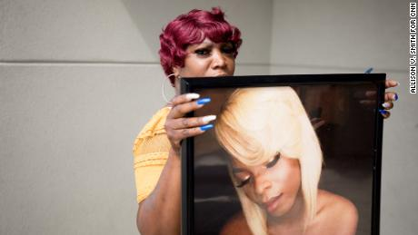 Theresa Whitehead holds a photograph of her friend Muhlaysia Booker, a transgender woman who was shot this month in Dallas, Texas.