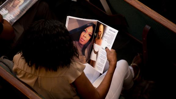 A friend of Muhlaysia Booker's  looks at the program during Muhlaysia Booker's funeral service at the Cathedral of Hope in Dallas, Texas.Muhlaysia Booker funeral  at the Cathedral of Hope in Dallas, Texas.photograph by Allison V. Smith