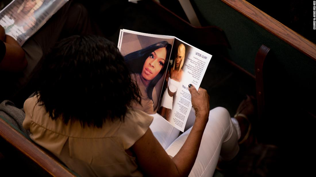 "The funeral program included recent photos of Booker and pictures of her before she transitioned, in what an organizer called a ""compromise"" for the family."