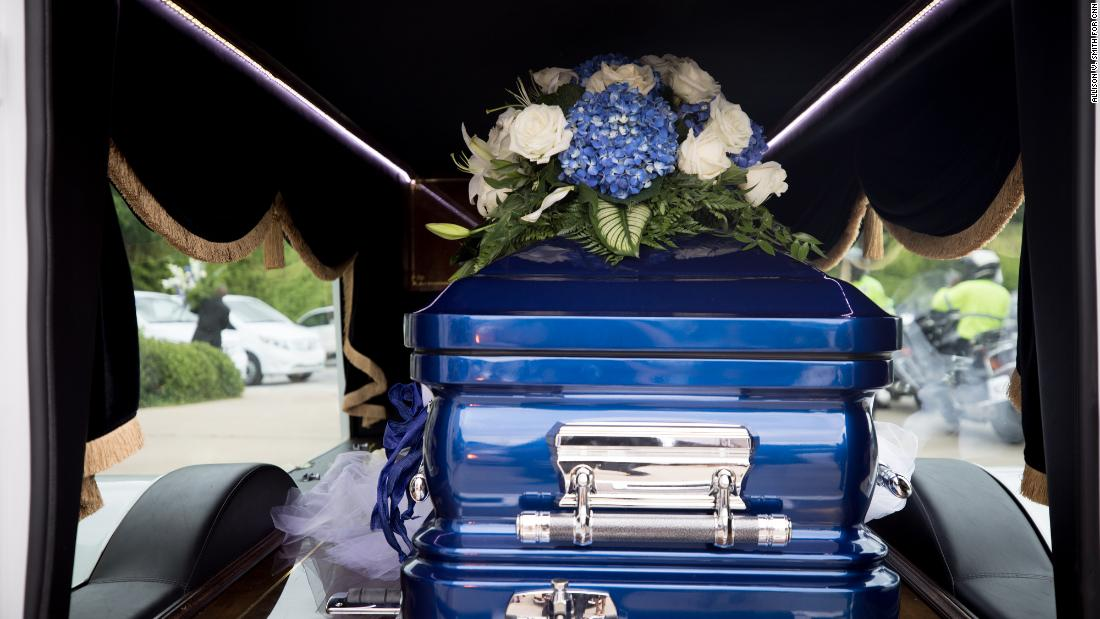 Blue and white were the colors of the funeral. Houston's mother said they were her favorite colors, but someone else said her favorite color was pink. Guests wore blue and white, and Booker's blue casket matched her bejeweled dress.