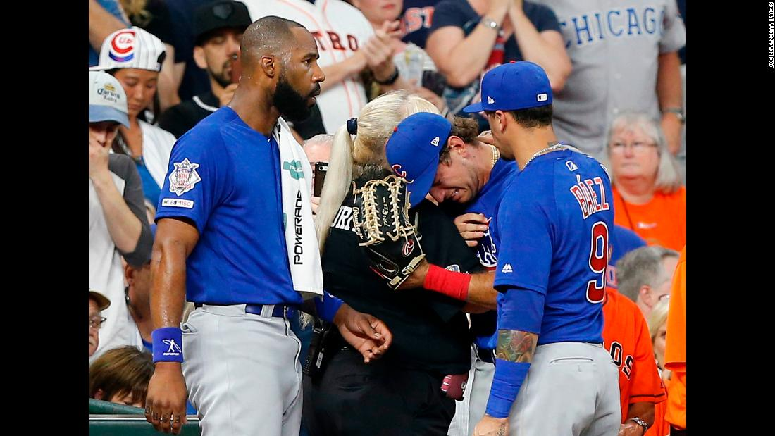 "Chicago Cubs outfielder Albert Almora Jr. is comforted by a security guard after checking in on the status of a young girl <a href=""https://www.cnn.com/2019/05/30/us/houston-foul-ball-hurts-child-trnd/index.html"" target=""_blank"">who was struck by a foul ball he hit</a> in Houston on Wednesday, May 29. Almora was distraught by the incident, throwing his hands behind his head immediately after seeing the impact. The girl was taken to a hospital, but her condition was not immediately available."