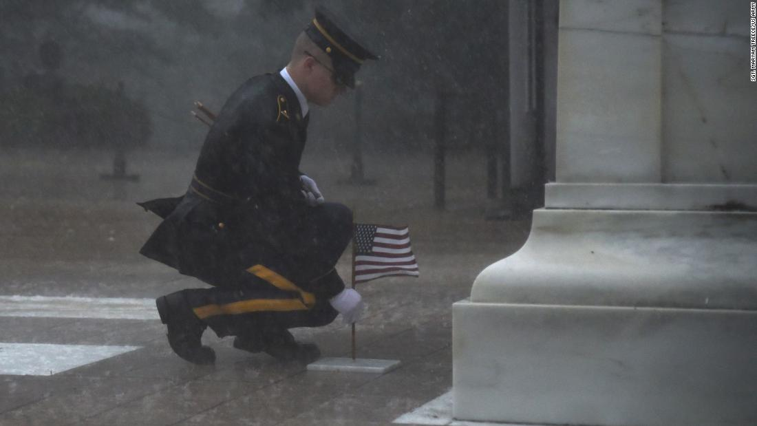 "A member of the 3rd US Infantry Regiment <a href=""https://www.cnn.com/2019/05/25/us/solider-braves-elements-to-honor-fallen-soldiers-trnd/index.html"" target=""_blank"">places a flag at the Tomb of the Unknown Soldier</a> during a severe storm in Arlington, Virginia, on Thursday, May 23."