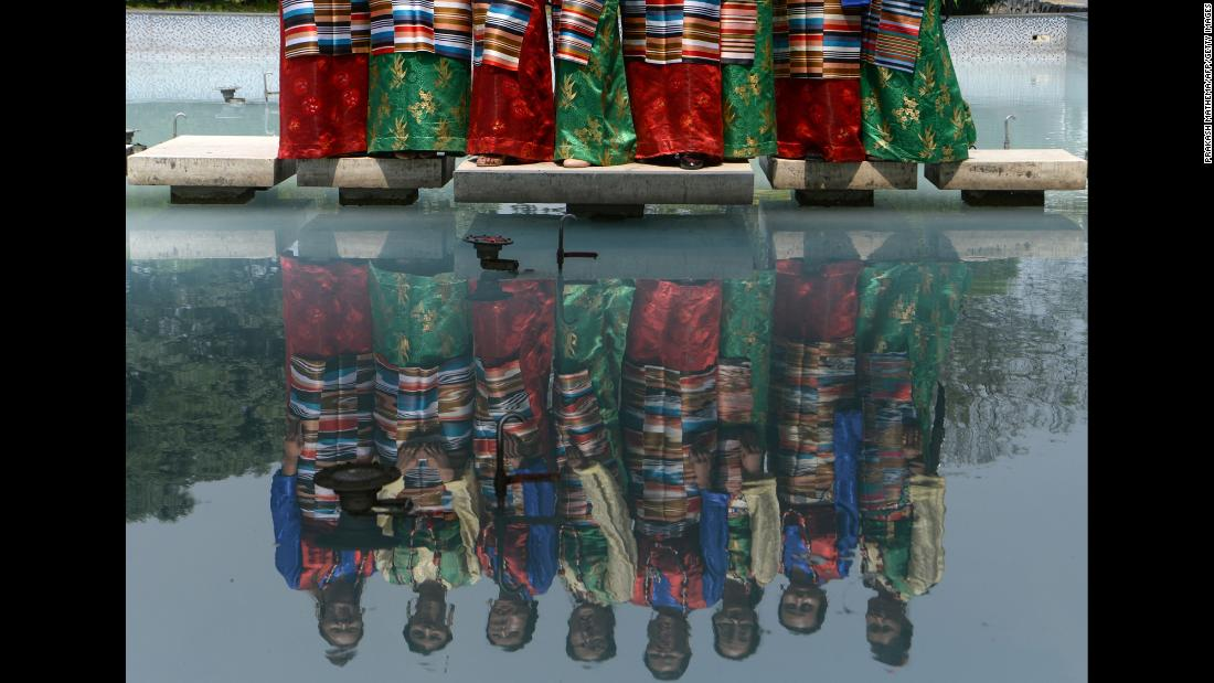 Sherpa women dressed in traditional attire pose for pictures Wednesday, May 29, during the 12th International Everest Day in Kathmandu, Nepal.