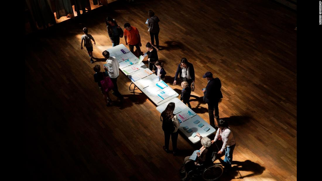 "Voters pick up ballots before voting in Lyon, France, on Sunday, May 26. Voters across 28 countries <a href=""https://www.cnn.com/2019/05/27/europe/european-elections-takeaways-intl/index.html"" target=""_blank"">were selecting new representatives</a> to sit in the European Parliament."