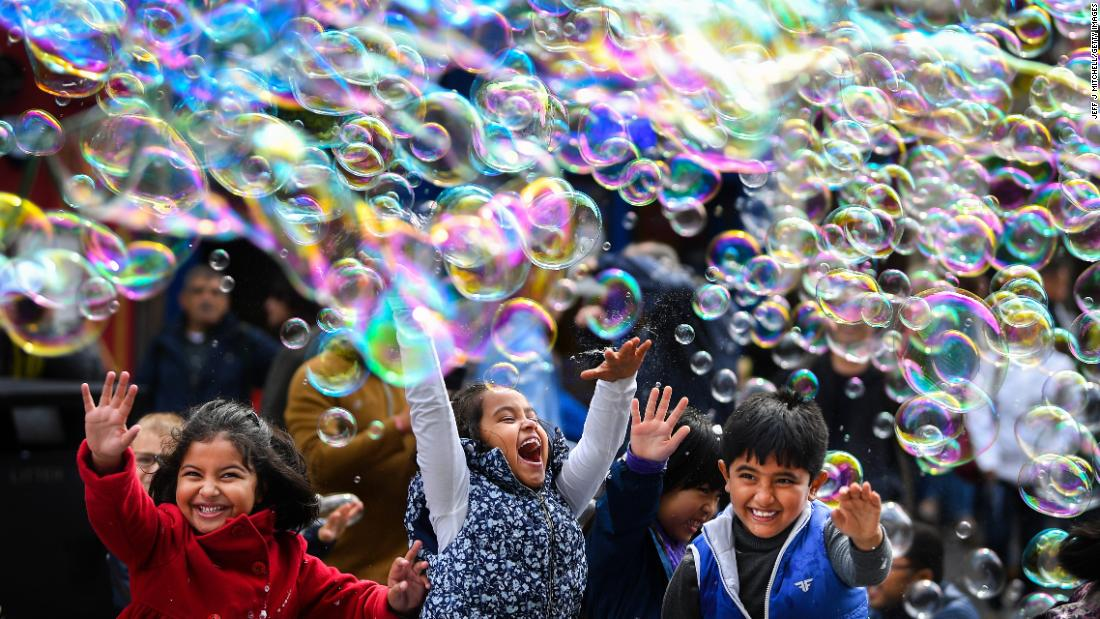 Children play in bubbles during a street performance in Edinburgh, Scotland, on Monday, May 27.